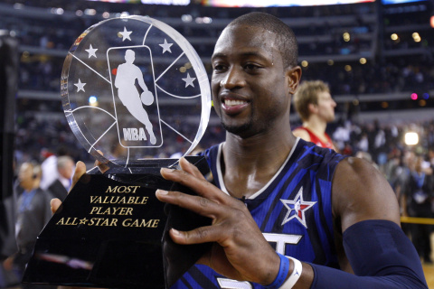 East All-Star Dwyane Wade of the Miami Heat holds his MVP trophy after the East defeated the West in the 2010 NBA All-Star Game in Dallas, Texas